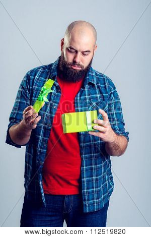 Frustrated Man With Green Gift Box