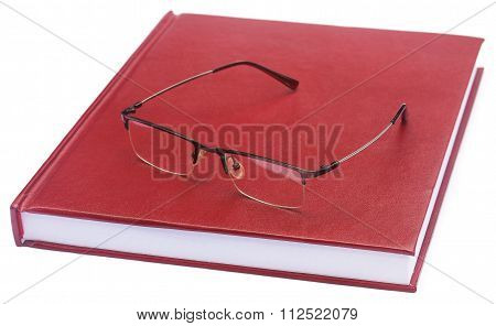 Maroon Colored Thesis Paper With Spectacles