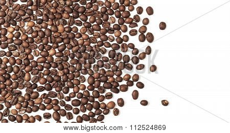 Layer Of Dark Roasted Coffee Beans Over White