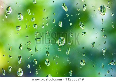 Raindrops On Clear Glass Window After Raining