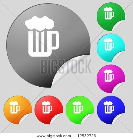 Glass Of Beer With Foam Icon Sign. Set Of Eight Multi Colored Round Buttons, Stickers.