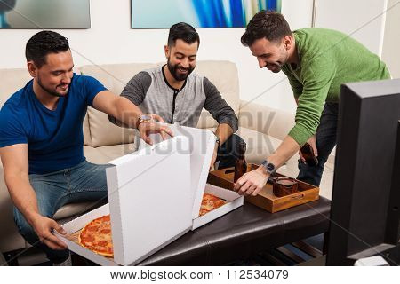 Male Friends Excited About Pizza