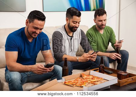 Male Friends Using Smartphones