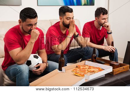 Stressed Soccer Fans Watching A Game