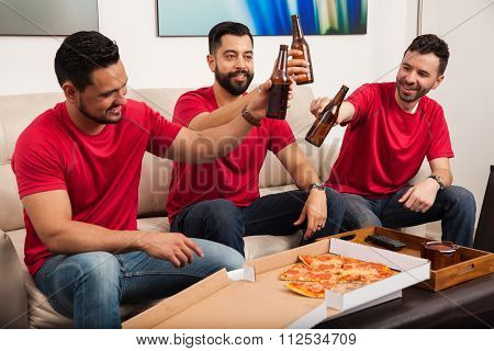 Friends Making Toast For Their Team