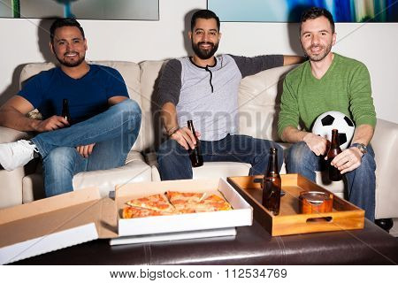 Guys Watching A Soccer Game At Home