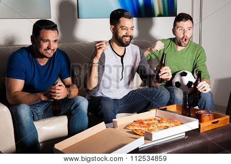 Friends Enjoying A Soccer Game On Tv