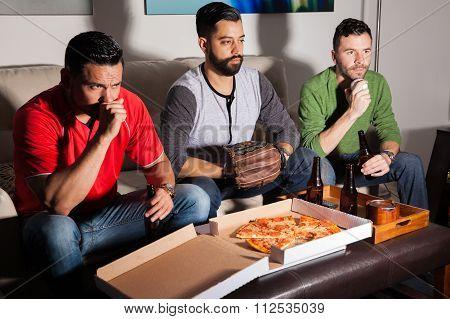 Worried Baseball Fans Watching A Game