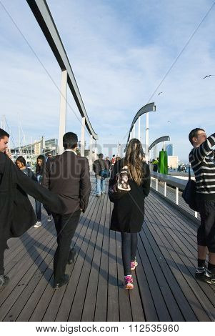 Barcelona, Spain - April 08: Rambla De Mar, A Modern Bridge In The Barcelona Port Area With People A