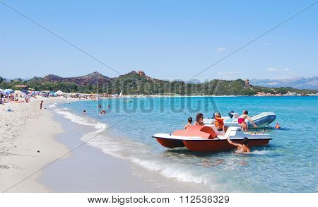Cea's Beach, Italy-AUGUST 05: Unidentified people in white beach with blue crystal sea, boat and pedal in summertime on August 05.2009 in Cea, Italy