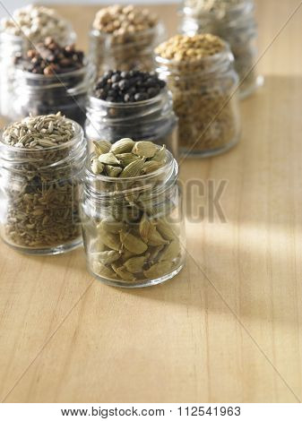 assorted spices on the wooden background
