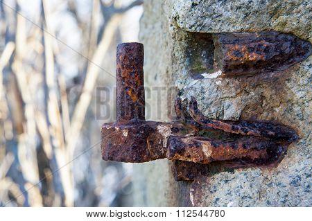 Eroding Hinge On Stone Wall