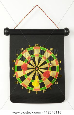 colorful dartboard with magnetic darts on a white background