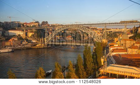 PORTO, PORTUGAL - CIRCA JUN, 2015: Ribeira, Luiz iron bridge in background. In 1996, UNESCO recognised Old Town of Porto as a World Heritage Site.