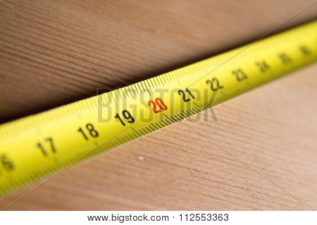 Measuring Tape On Wood