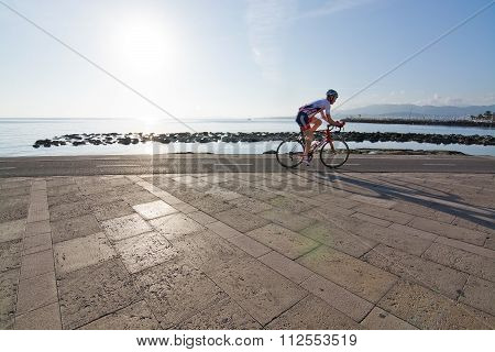 Bicyclist On The Molinar Boardwalk