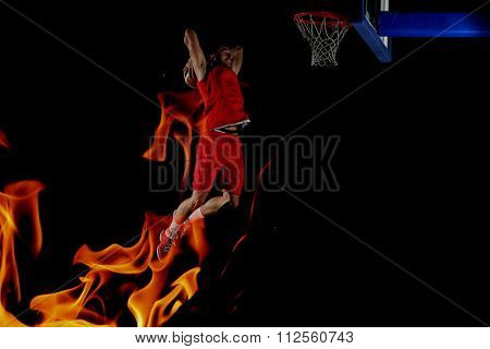 double exposure of  fire and  basketball  player,  sport player in action isolated on black background