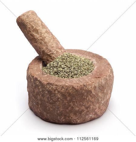 Organic Aniseed in mortar.
