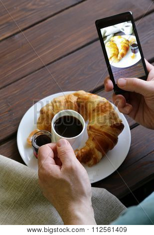 smartphone shot food photo - croissants with jam for breakfast
