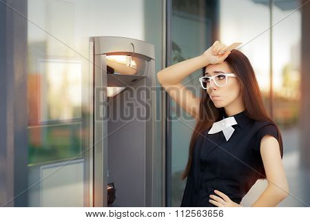Stressed Woman with credit card at ATM