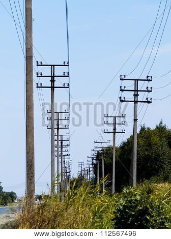 high voltage towers standing in line