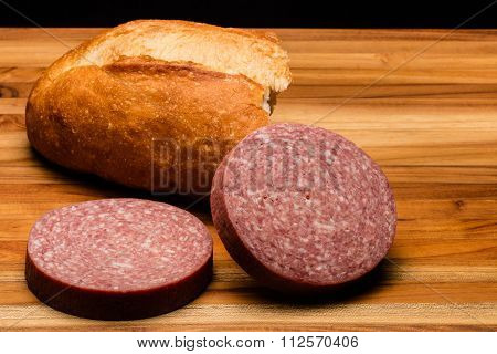 Torn Italian Bread With Two Chunks Of Salami