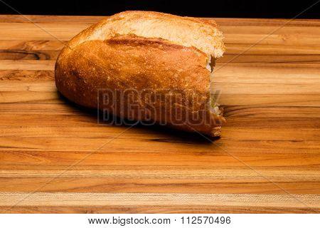 Torn Italian Bread On Cutting Board