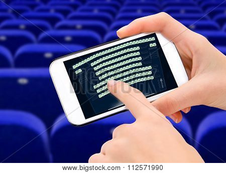 Smart phone and cinema ticket.