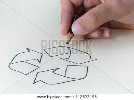 A Child Drawing The Recycling Symbol With A Very Short Pencil Stub
