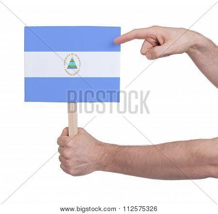 Hand Holding Small Card - Flag Of Nicaragua