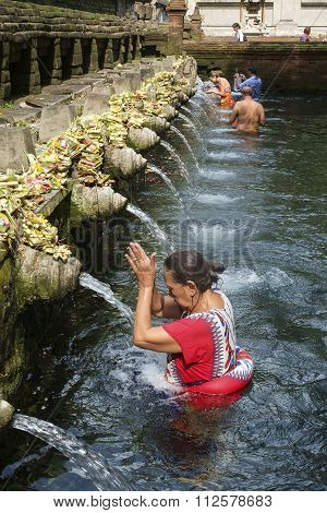 Balinese people praying at holy spring water at Pura Tirtha Empul