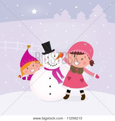 Winter and christmas: Two happy children making snowman