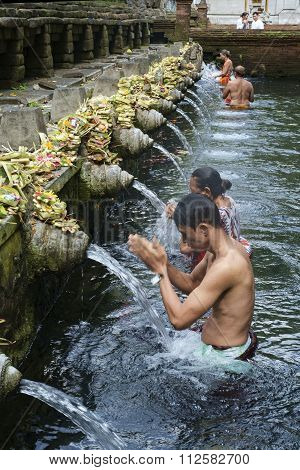 Bali, Indonesia, September 09, 2014 : Balinese People Praying At Holy Spring Water At Pura Tirtha.