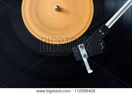 record player stylus on a rotating disc