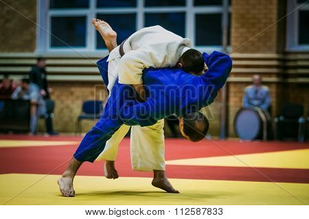 men judokas during match