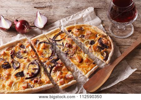 Flammkuchen Sliced Pie And Red Wine Close-up. Horizontal