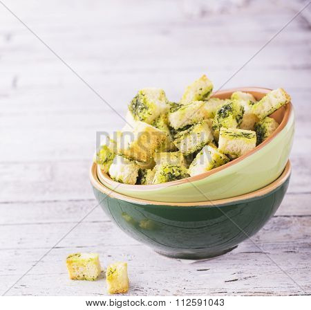 Crunchy homemade croutons with herbs and butter