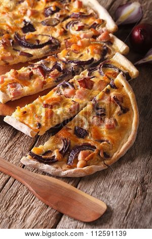 Sliced Pie Flammkuchen With Bacon And Red Onion Close-up. Vertical