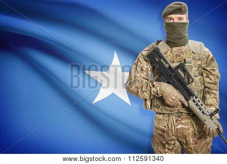 Soldier Holding Machine Gun With Flag On Background Series - Somalia