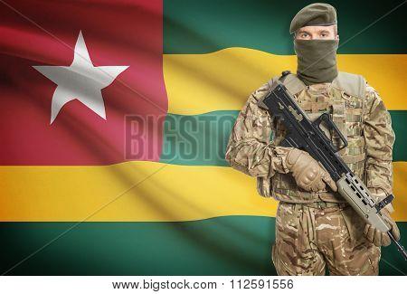 Soldier Holding Machine Gun With Flag On Background Series - Togo