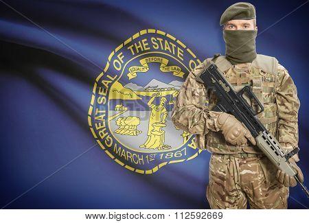 Soldier Holding Machine Gun With Usa State Flag On Background Series - Nebraska