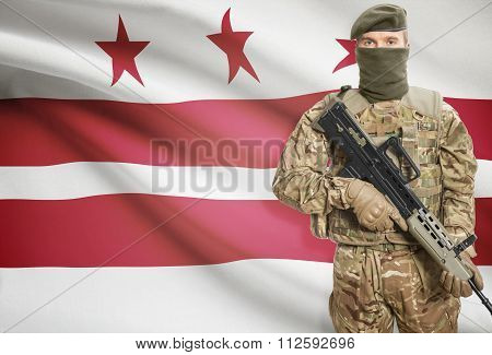 Soldier Holding Machine Gun With Usa State Flag On Background Series - District Of Columbia