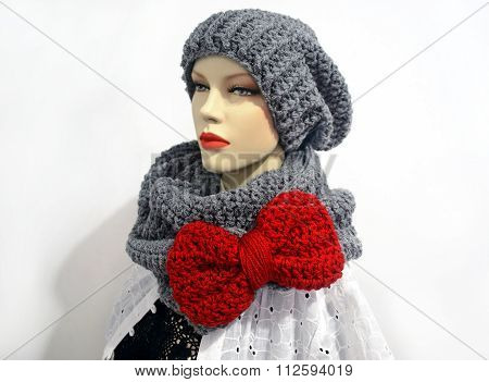 doll wearing grey scarf and beanie
