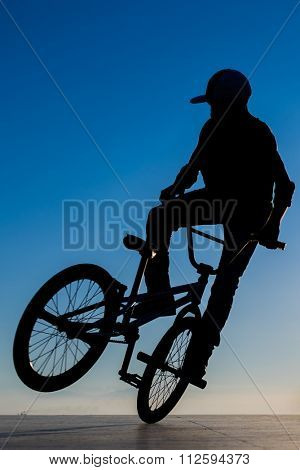 Street Stunt bicycle young man  silhouette