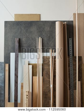 Various supplies for woodworking, crafting materials in workshop.