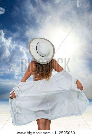 Woman with sarong on beach  at Seychelles, Mahe
