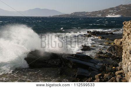 waves breaking on the beach rocks