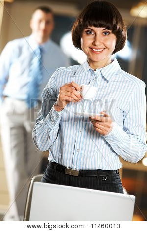 Businesswoman With Cup