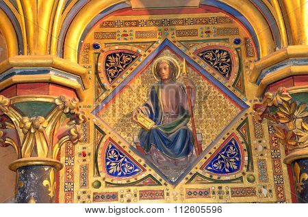 PARIS, FRANCE - SEPTEMBER 8, 2014: Paris - Interiors of the Sainte-Chapelle (Holy Chapel). The Sainte-Chapelle is a royal medieval Gothic chapel in Paris and one of the most famous monuments of the city . Medallion set with fake gems representing the apos