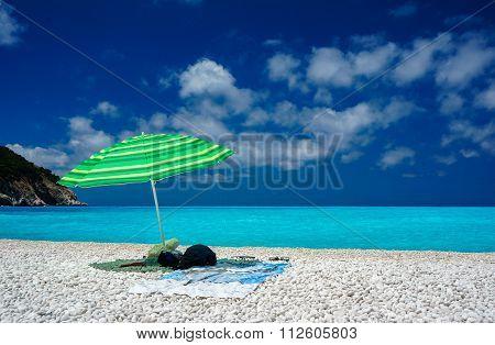 Umbrella by a beach in Kefalonia